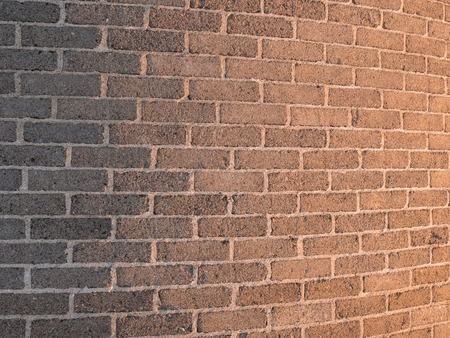 Curved brick wall with light gradient