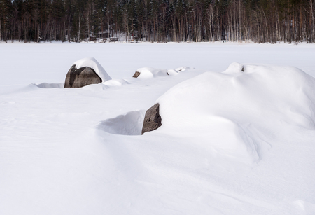 Shore stones covered by white snow