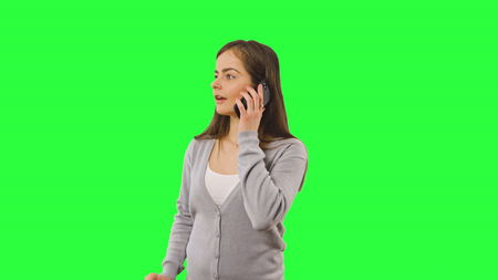 Woman smile cell phone call close up face portrait over green chroma key screen background