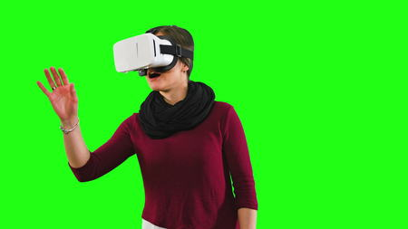 woman with glasses of virtual reality seen around surprise emotion on green screen background
