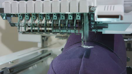Embroidery machine deals logo on the cap dolly shoot