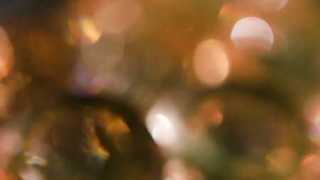 The Circles Bokeh stock video features a circle rotation in a clockwise direction of gold blurred lights. You can use it as an overlay for creative video effects, artistic videos, and as a texture by changing the blending mode to add or screen.