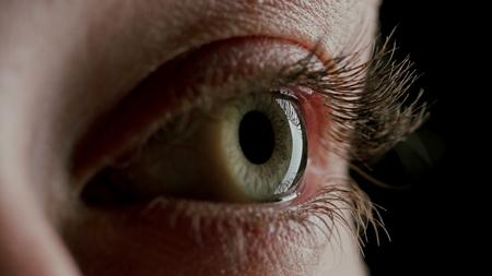 close up macro human eye opening blinking light revealing beautiful iris