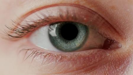 close-up macro eye opening human iris natural beauty Stock fotó