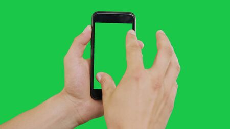 Zooming Out Smartphone Green Screen. Pointing Finger Clicking On Phone Screen with Green Background. Use in any project that depicts finger, gesture, touchscreen and the like.
