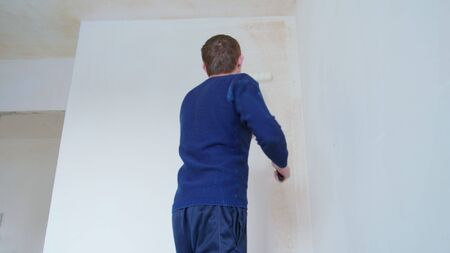 Man painting the room white. Decoration
