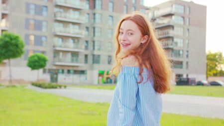 Red-haired lady. Emotion. Smile Medium shot