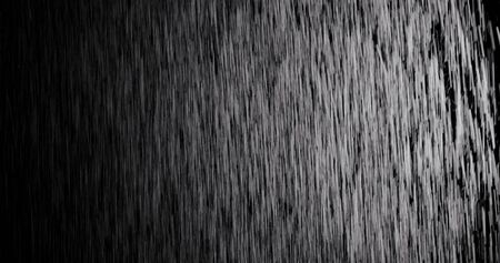 A lot of raindrops of white water falling down. Perfect for digital composing. Pure black background. 版權商用圖片