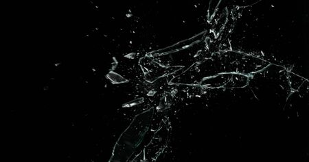 Broken cracks glass fracture effect texture isolated abstract black background. Bullet cracked window with big hole screen mirror weapon shot.