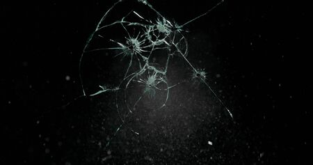 Broken cracks glass fracture effect texture isolated abstract black background. Bullet cracked window with big hole screen mirror weapon shot. Archivio Fotografico