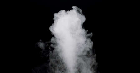plume of smoke bubbling up against a black background.
