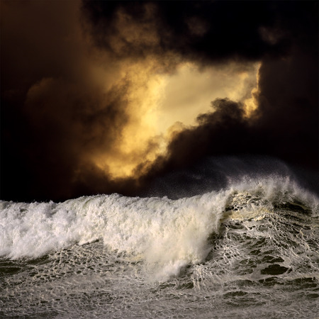 Photo composition with big wave and cloudy sky in a stormy sunset in the portuguese coast