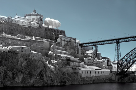 Monastery of Serra do Pilar built in the sixteenth and seventeenth century on a Douro River bluff near its mouth. Vila nova de Gaia, twin city of Porto, Portugal. Used infrared filter.  photo