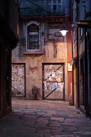 Night view of a messy alley of old Porto, Portugal