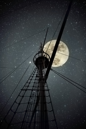 old moon: Topmast and cables of an old portuguese ship from the time of the discoveries against a clear full moon night with stars