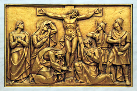 Golden bas-relief of the old Basilica of Fatima representing one of the fourteen mysteries of the rosary, similar to the stations of the cross. This bas-relief depicts Jesus Christ on the Cross. photo