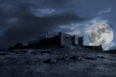 castle rock: Medieval dark scenery with old castle, clouds and full moon at night Stock Photo