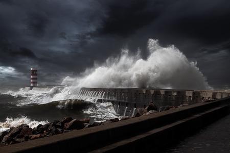 Lighthouse and pier under heavy storm. Enhanced sky. Stock Photo