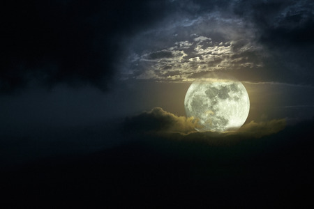 moonrise: Illustration of a beautiful moonrise in a cloudy night; full moon; added some digital noise Stock Photo