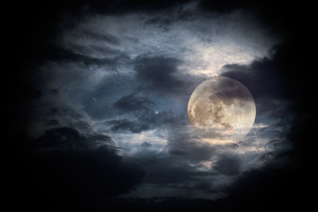 moon surface: Illustration of an interesting full moon in a cloudy night Stock Photo