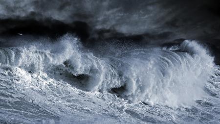 Big Atlantic wave over Portuguese cost. Enhanced sky. toned blue
