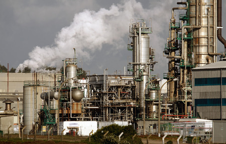 Part of a big oil refinery seeing steam