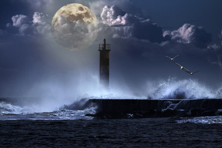 Conceptual image over an unlit beacon in a stormy full moon night photo