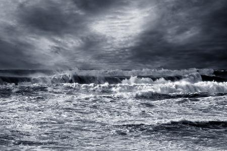 Storm in ocean with windy waves. Northeast Atlantic Coast. Enhanced sky. Toned blue.