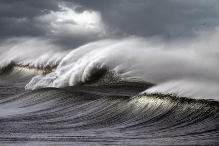 hurricane: Big stormy waves crashing over Portuguese Coast - enhanced sky Stock Photo
