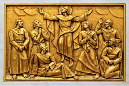 ascended: One of the golden bas-relief of the old Basilica of Fatima representing one of the fourteen mysteries of the rosary (similar to the stations of the cross) in one of his fourteen side altars. This bas-relief depicts Jesus ascended to heaven.  Stock Photo
