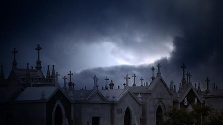 dramatic: Old european cemetery against dramatic cloudy sky at dusk