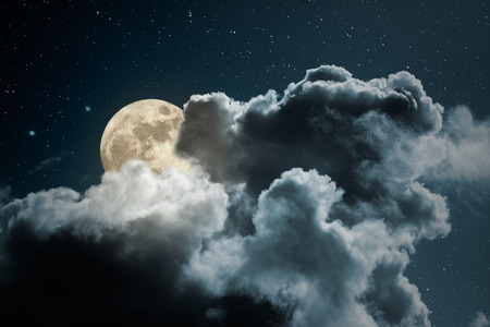 full moon: Full moon behind the clouds on a starry night