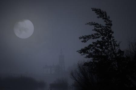 Medieval river city of Ponte de Lima, north of Portugal, in a foggy full moon night Archivio Fotografico