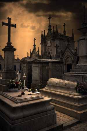 moody background: Spooky Halloween european graveyard with dark clouds Stock Photo
