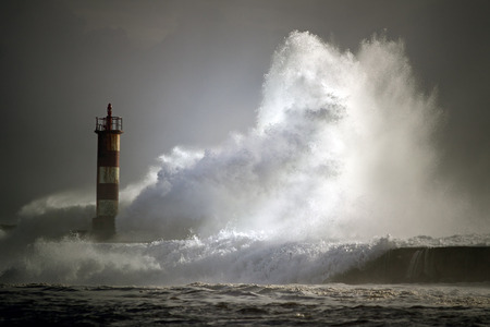 Lighthouse of the river Ave entrance in a stormy evening, Vila do Conde, north of Portugal photo