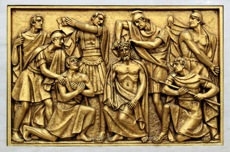 Golden bas-relief of the old Basilica of Fatima representing one of the fourteen mysteries of the rosary, similar to the stations of the cross. This bas-relief depicts Jesus crown of thorns. photo