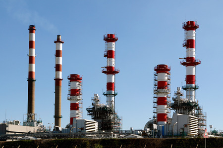 Part of a big oil refinery and powerplant  against blue sky showing some new equipment