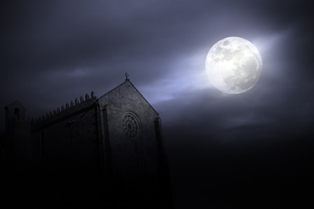 full house: Medieval european monastery lit by the full moon