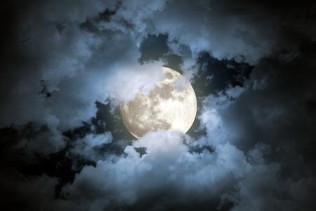 nebulous: Beautiful cloudy full moon night Stock Photo