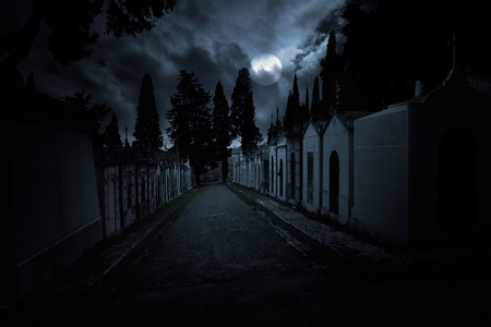 Scary old cemetery in a cloudy full moon night  photo
