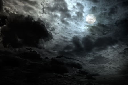 Cloudy full moon night with interesting light