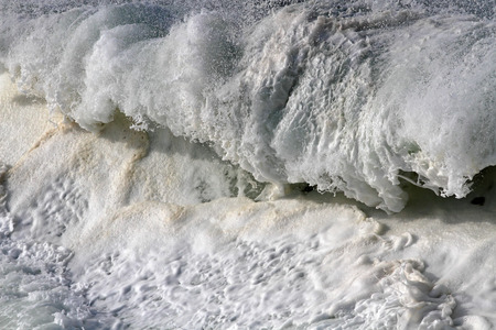 detailed image: Detailed image of a large breaking oceanic wave seeing foam Stock Photo