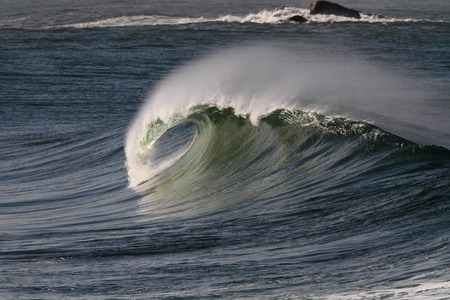 huge: Big ocean wave with tube and spray. North of Portugal. Stock Photo