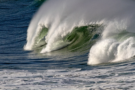 wind surfing: Big ocean wave with tube and spray. North of Portugal. Stock Photo