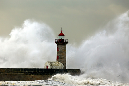 Stormy waves over lighthouse, Porto, Portugal