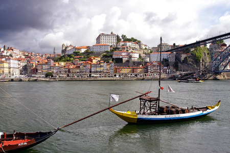 rabelo: Porto, Portugal - May 26, 2012: Colorful Oporto Ribeira by the morning. UNESCO site. Editorial