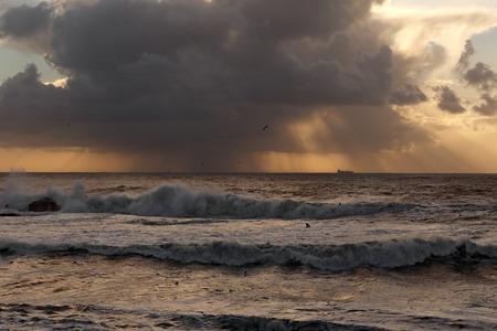 Rain approaching the Oporto coast at sunset photo