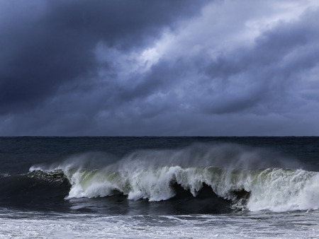 enhanced: Moody seascape with windy wave. Enhanced sky. North of Portugal.