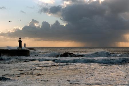 oporto: Rain approaching the Oporto coast at sunset