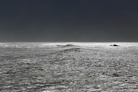 glistening: Interesting glistening sea at noon. North of Portugal. Stock Photo
